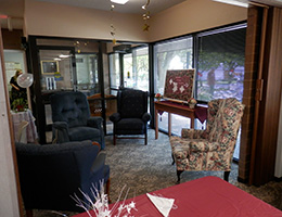 Pilgrim Place lounge area with seating and view outdoors