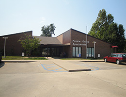 front of the facility and parking lot on a sunny day