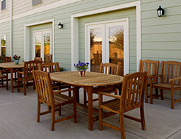 Providence Place outdoor patio dining area with teak tables and chairs