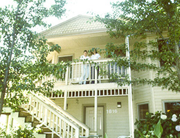 River City resident rooms with stairs leading up and two ladies out on the balcony
