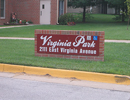 Virginia Park brick sign surrounded by grass