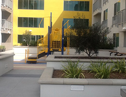 Whittier yellow accent wall on exterior of building