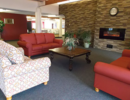 indoor lobby area with nice couches and a fireplace