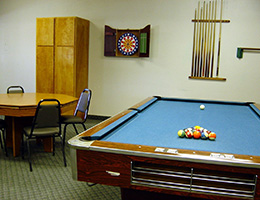 Mayflower Gardens recreation area with pool table