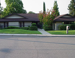 Redding Cottonwood housing community with lush green grass and side walk