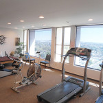 RHF Bixby Knolls exercise room with expansive views of the city
