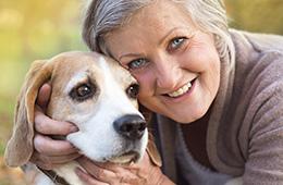 smiling woman hugging a dog