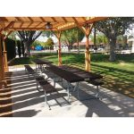 Picnic area outdoor with a pergola and bbq pits near by