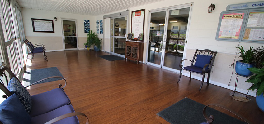 Community entrance with clean wood floors.