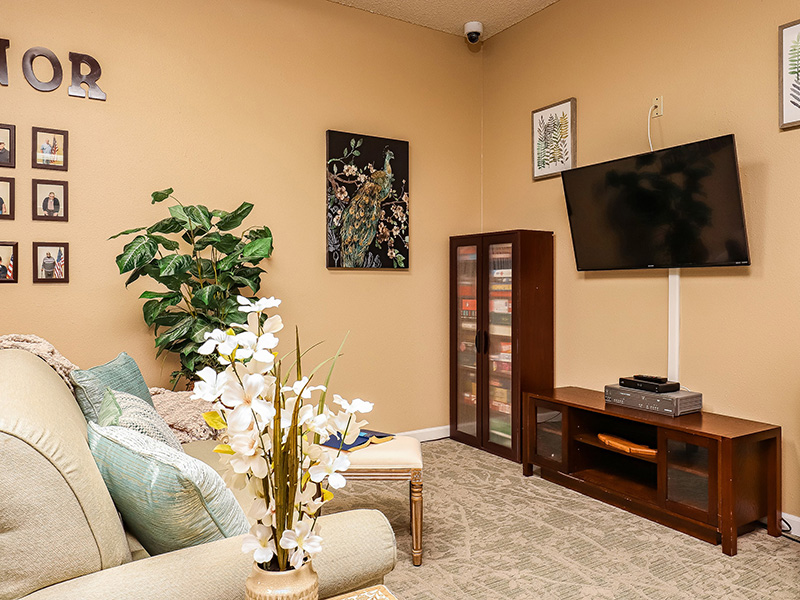 Game Room with comfortable seating and a TV on the wall.
