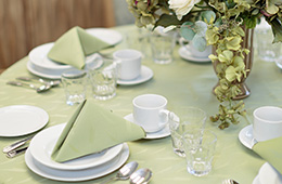 ornate table setting with lots of glasses and silverware