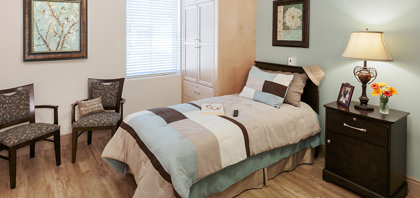 close up on one bed in a hardwood floored room