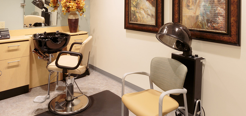 salon area with chairs, a hair wash station and a steam machine