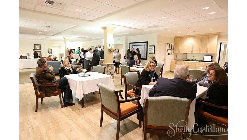 a busy lobby area with tables and chairs