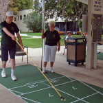 RHF Bishop's Glen residents playing shuffleboard at the facility