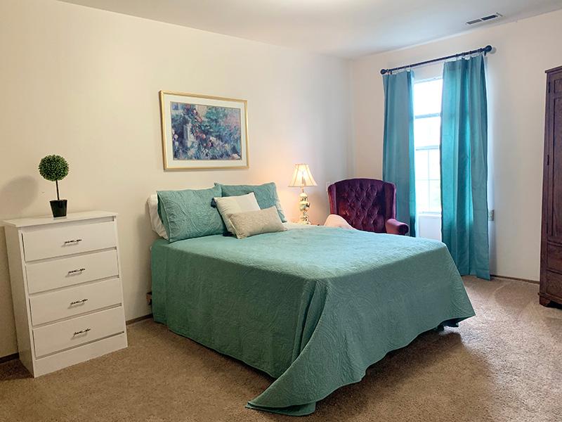 DeSmet queen bed, soft chair, dresser, window