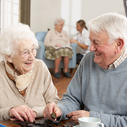 smiling couple sitting in the recreation room