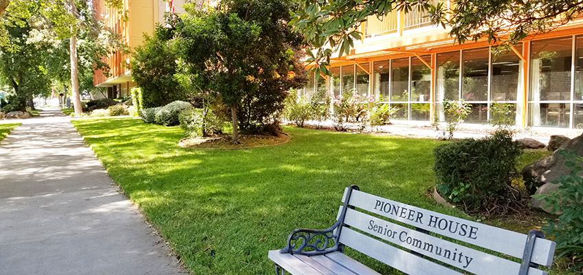 Pioneer House outdoor bench and sidewalk