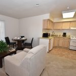 RHF Gateway resident kitchen, dining area, and living area