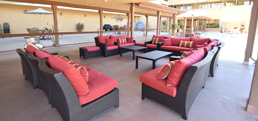 RHF Gateway outdoor seated area with couches and covered area