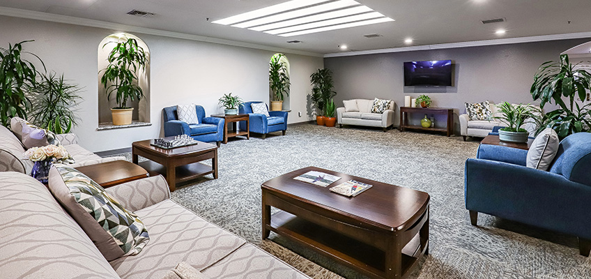 Large, open space with several options for relaxing and a table set up for reading magazines and playing a game.