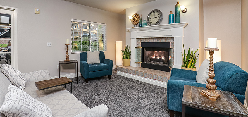 Gateway Gardens living room area with fireplace