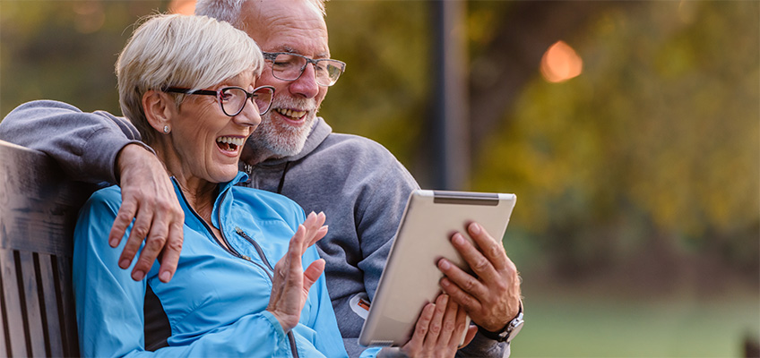 Senior couple searching the internet on a tablet computer