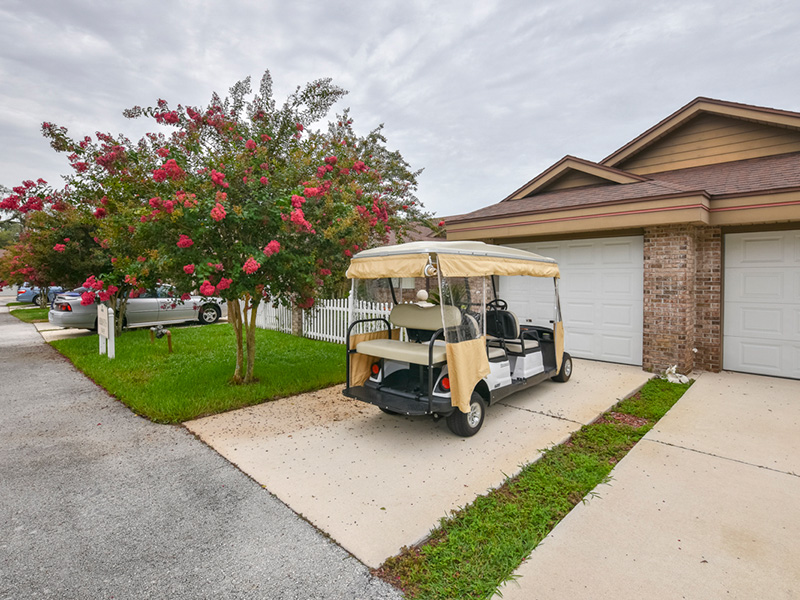 Golf cart in the driveway of a residence