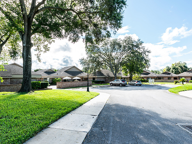 Resident community with sidewalks and grass.