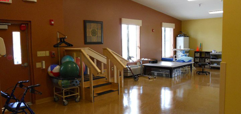 exercise room with exercise balls, therapy tables and stairs