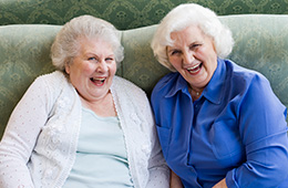 two female friends having a good laugh