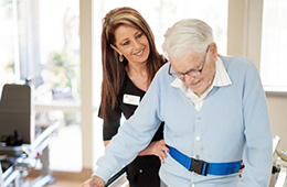 elderly man doing walking physical therapy