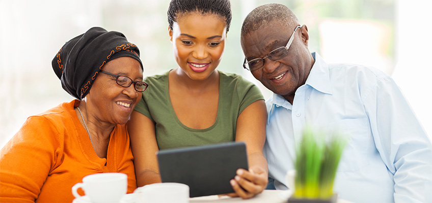 A family looking at a tablet together.