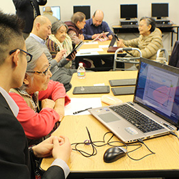 seniors learning computers in the activity center