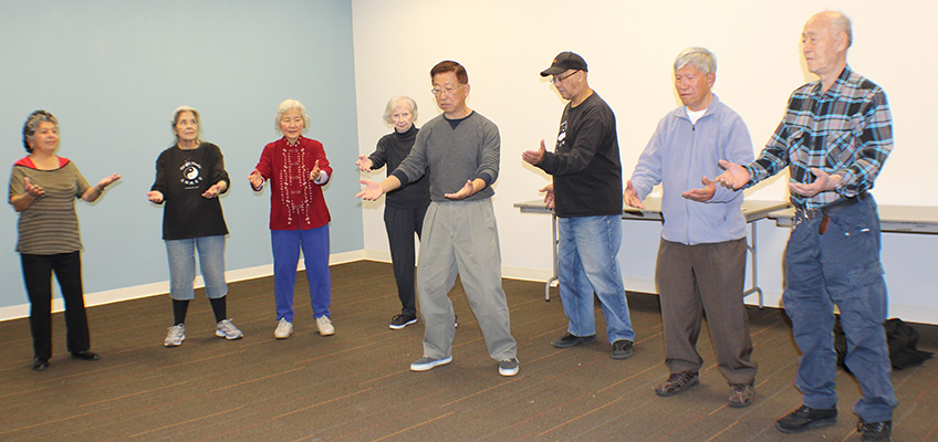 residents being led in a Tai Chi class