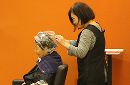 female resident getting her hair done in the salon