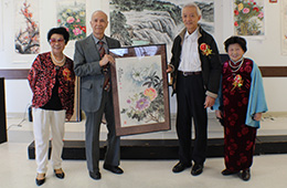presenting a piece of artwork to the center
