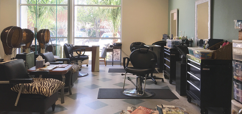 The Towers of Jacksonville Salon with full service stations, sitting areas to dry hair and a waiting area with magazines on the table