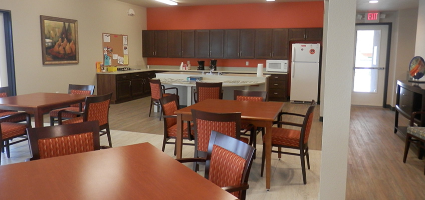 College Villas dining area equipped with refrigerator, microwave, cupboards, tables and chairs
