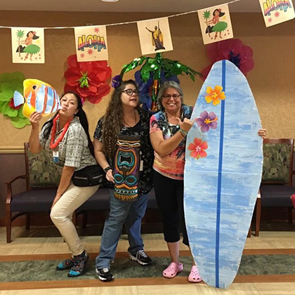 aloha day with people wearing hawaiian and surfer gear