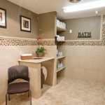 bath room with tiled walls and floor