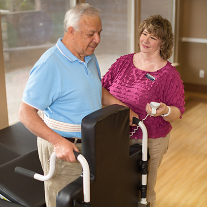 man doing physical therapy while smiling