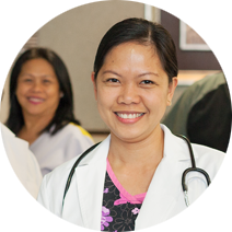 doctor smiling with coworkers behind her