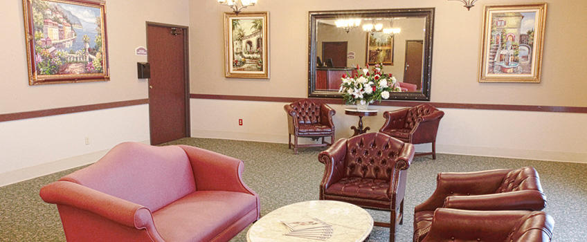lobby photo of couch and chairs with fresh flowers