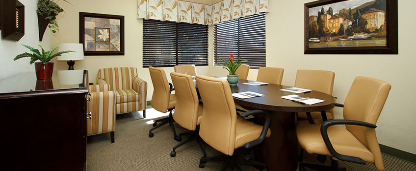 conference room area with 8 chairs on a long table