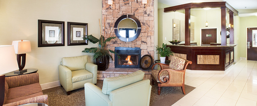 lobby area with a fireplace and chairs