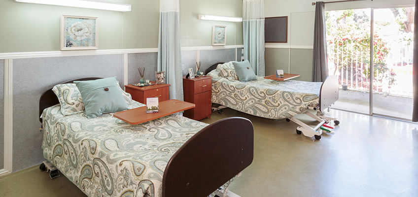 two bed room with nice sheets and sliding glass door
