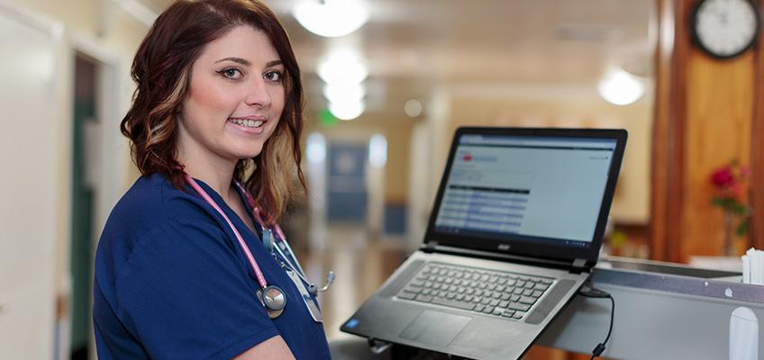 pretty nurse with laptop