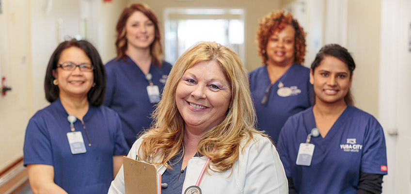 doctors and nurses in a staff photo