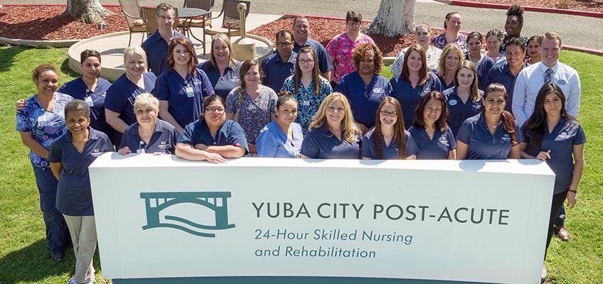 yuba city post acute signage with large staff photo outside